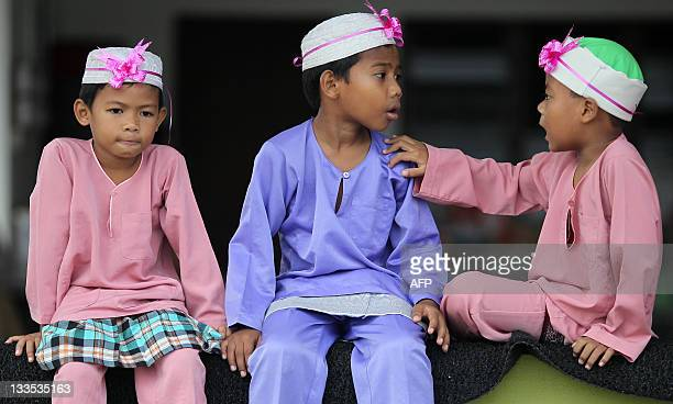 Boys wait their turn to take part in a mass circumcision ceremony in Kajang outside Kuala Lumpur on November 20 2011 About 30 boys aged between 7 and...