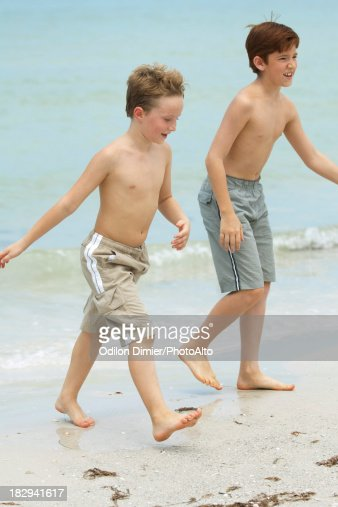 Boys Walking On Beach Stock Photo Getty Images