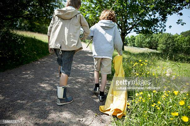 Boys walking on dirt road