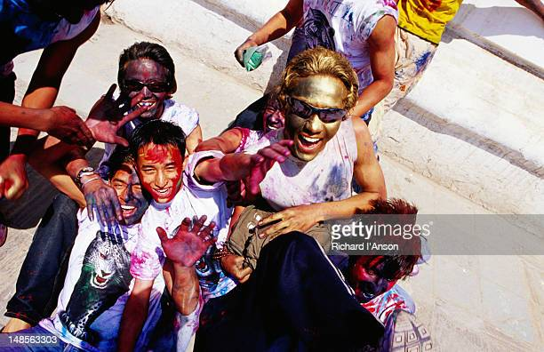 Boys with coloured faces during Holi (festival of colour).