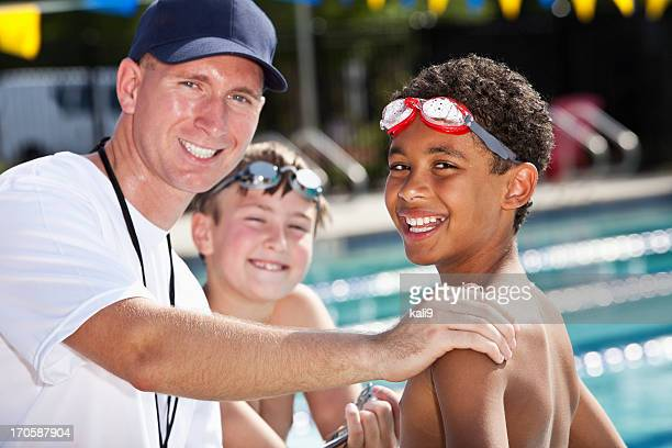 Boys with swim coach