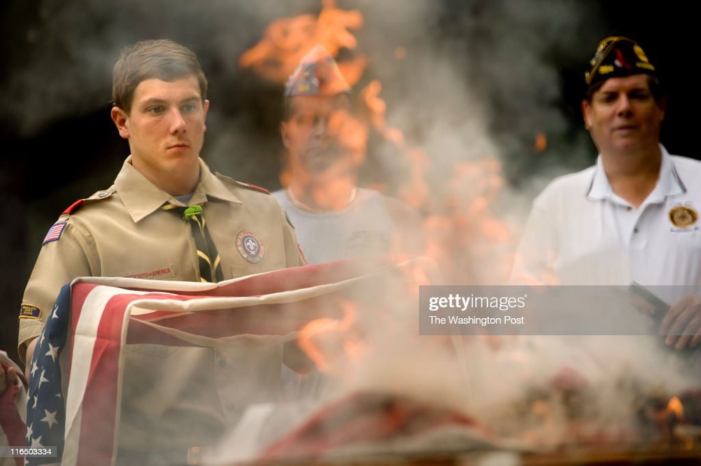 Boyscout Andy Blevins from Troop 1367as he participates in a flag retirement ceremony in Woodbridge VA on June 14 2011 Members of the American Legion...