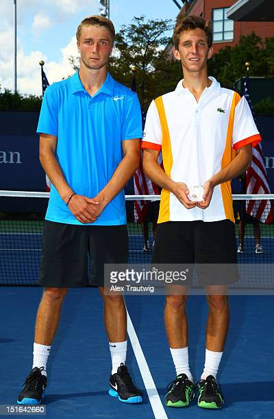 Boys's singles champion Filip Peliwo of Canada poses next to Liam Broady of Great Britain following their boys' singles final match on Day Fourteen...