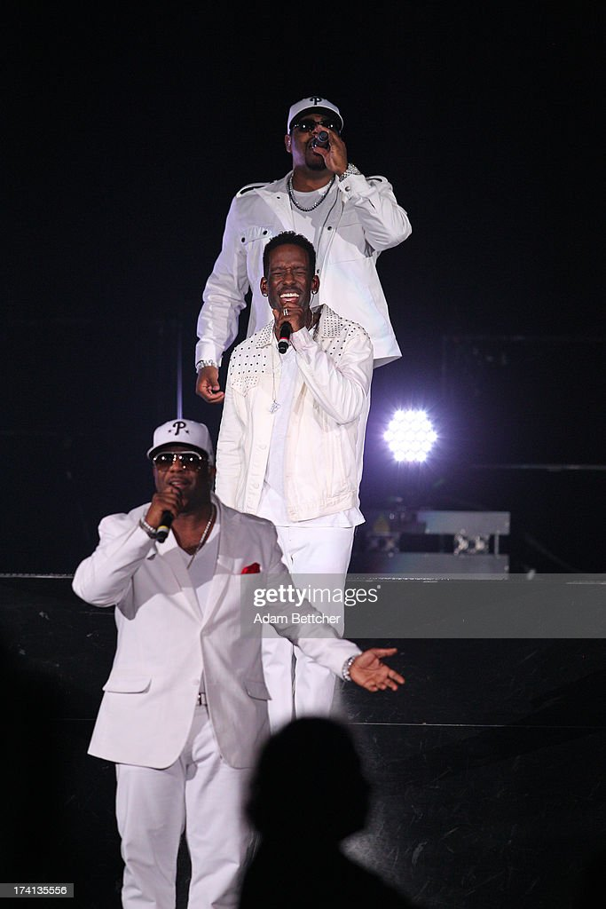 Boyz II Men singers Nathan Morris, Wanya Morris and Shawn Stockman perform during 'The Package Tour' concert at Target Center on July 20, 2013 in Minneapolis, Minnesota.