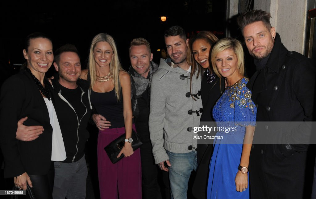 Boyzone and partners (L to R) Karen Corradi, Mikey Graham, Storm Keating, Ronan Keating' Shane Lynch, Sheena White, Lisa and Keith Duffy sighting at The Ivy on November 5, 2013 in London, England.