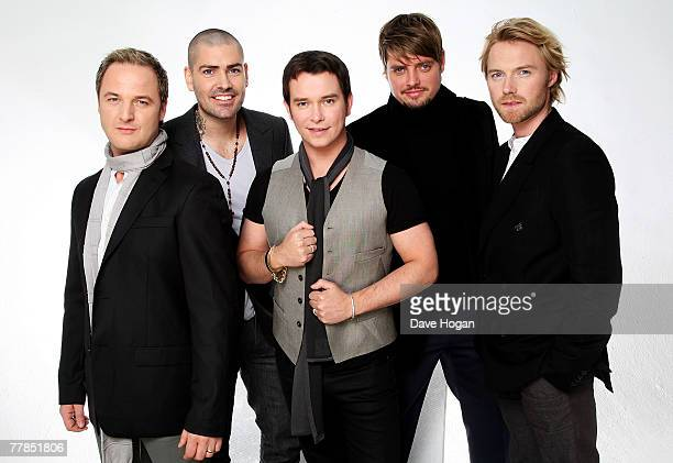 Boyzone members Mikey Graham Shane Lynch Stephen Gately Keith Duffy and Ronan Keating pose during a portrait session to mark the reunion of the Irish...