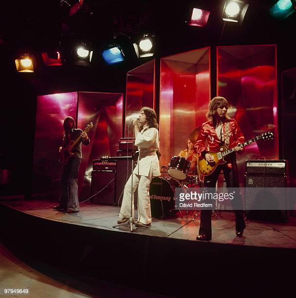 Boz Burrell Paul Rodgers Simon Kirke and Mick Ralphs of Bad Company perform on the BBC television show 'Top of the Pops' in June 1974