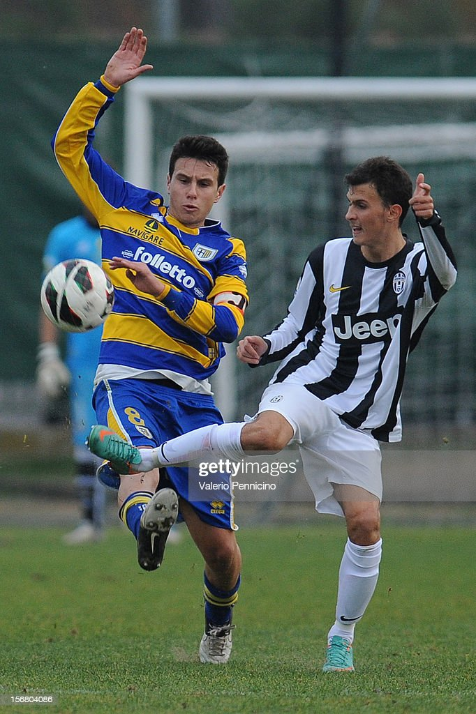 Braccini (R) of Juventus FC competes with Moroni of FC Parma during the Juvenile match between Juventus FC and FC Parma at Juventus Center Vinovo on November 21, 2012 in Vinovo, Italy.