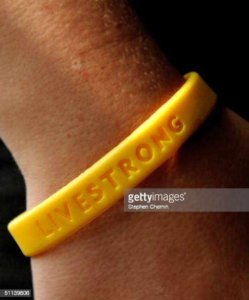 A 'LIVESTRONG' bracelet is worn in this photo August 3 2004 In late May 2004 Nike and the Lance Armstrong Foundation joined forces and created the...