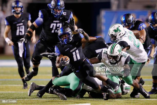 Brad Anderson of the Middle Tennessee Blue Raiders gets tackled from behind while running the ball in the third quarter of a game against the...