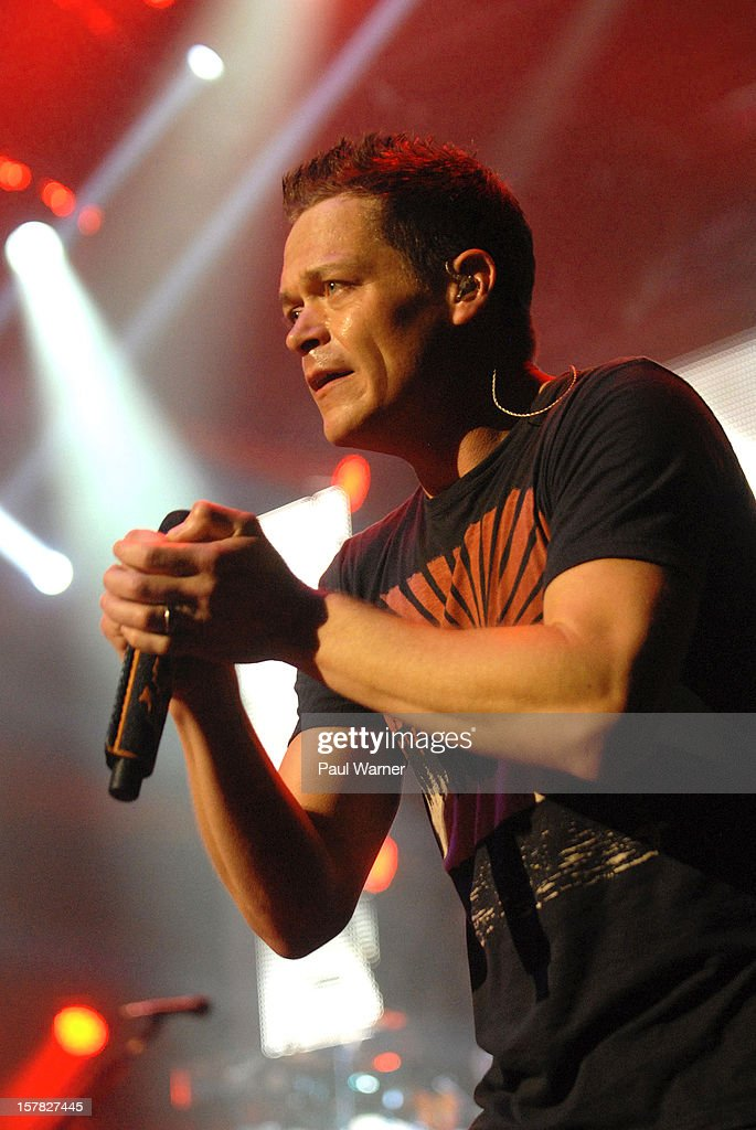<a gi-track='captionPersonalityLinkClicked' href=/galleries/search?phrase=Brad+Arnold&family=editorial&specificpeople=217763 ng-click='$event.stopPropagation()'>Brad Arnold</a> of Three Doors Down performs with the band at Fox theater on December 5, 2012 in Detroit, Michigan.
