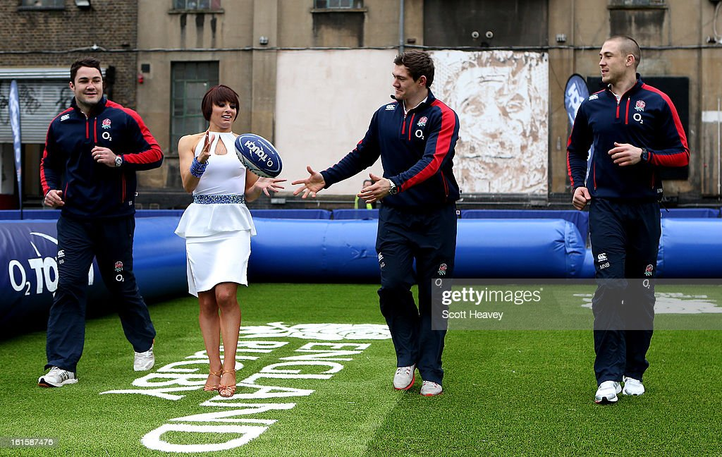 Brad Barrit, Mike Brown and Alex Goode play touch rugby with Flavia Cacace from Strictly Come Dancing during the Launch of the O2 Touch Campaign on February 12, 2013 in London, England.
