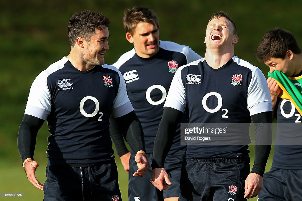 Brad Barritt (L) and Chris Ashton (R) share a joke during the England training session at Pennyhill Park on November 22, 2012 in Bagshot, England.