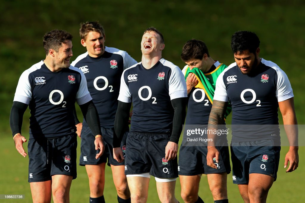 Brad Barritt (L) and Chris Ashton (C) share a joke during the England training session at Pennyhill Park on November 22, 2012 in Bagshot, England.