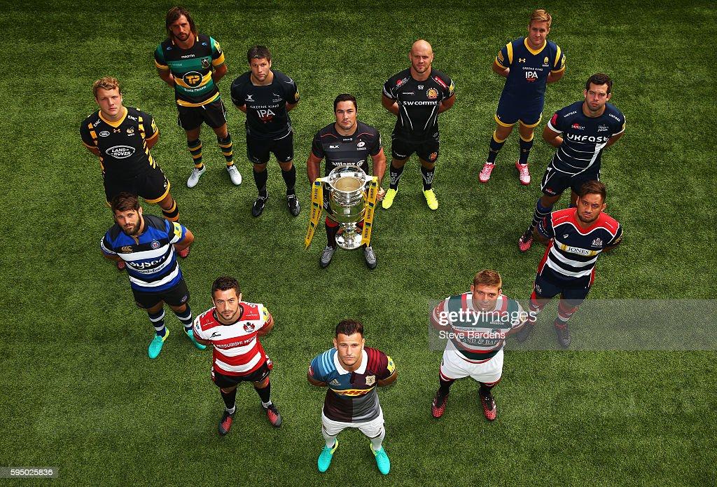 Brad Barritt Captain of Saracens holds the Aviva Premiership Trophy as the twelve Captains form a heart shape at the Aviva Premiership Rugby Season...
