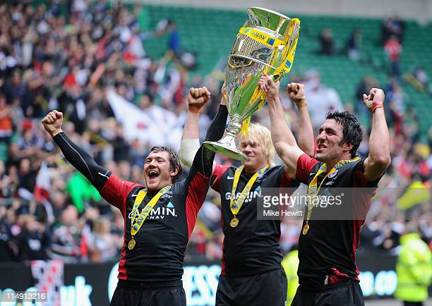 Brad Barritt Mouritz Botha and Kelly Brown of Saracens celebrate with the Aviva Premiership Trophy during the AVIVA Premiership Final between...