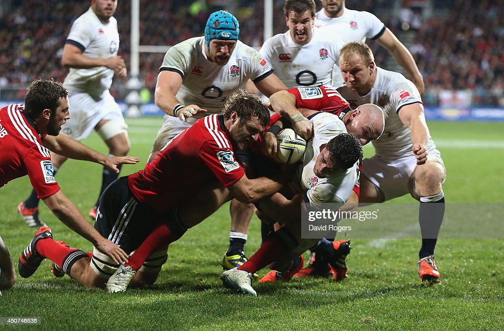 <a gi-track='captionPersonalityLinkClicked' href=/galleries/search?phrase=Brad+Barritt&family=editorial&specificpeople=4542508 ng-click='$event.stopPropagation()'>Brad Barritt</a> of England dives over for a try during the match between the Crusaders and England at the AMI Stadium on June 17, 2014 in Christchurch, New Zealand.