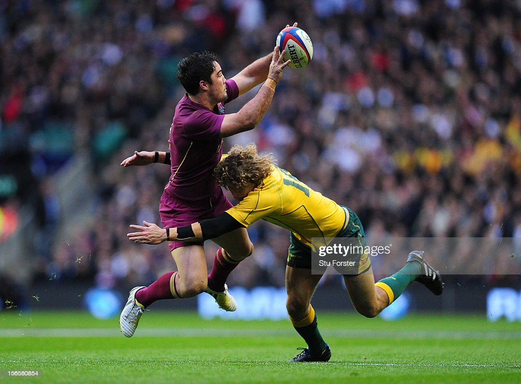 <a gi-track='captionPersonalityLinkClicked' href=/galleries/search?phrase=Brad+Barritt&family=editorial&specificpeople=4542508 ng-click='$event.stopPropagation()'>Brad Barritt</a> (L) of England in action with Nick Cummins (R) of Australia during the QBE International match between England and Australia at Twickenham Stadium on November 17, 2012 in London, England.