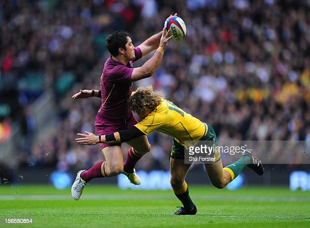 Brad Barritt of England in action with Nick Cummins of Australia during the QBE International match between England and Australia at Twickenham...