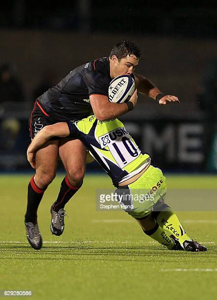 Brad Barritt of Saracens and AJ MacGinty of Sale Sharks during the European Rugby Champions Cup match between Saracens and Sale Sharks at Allianz...