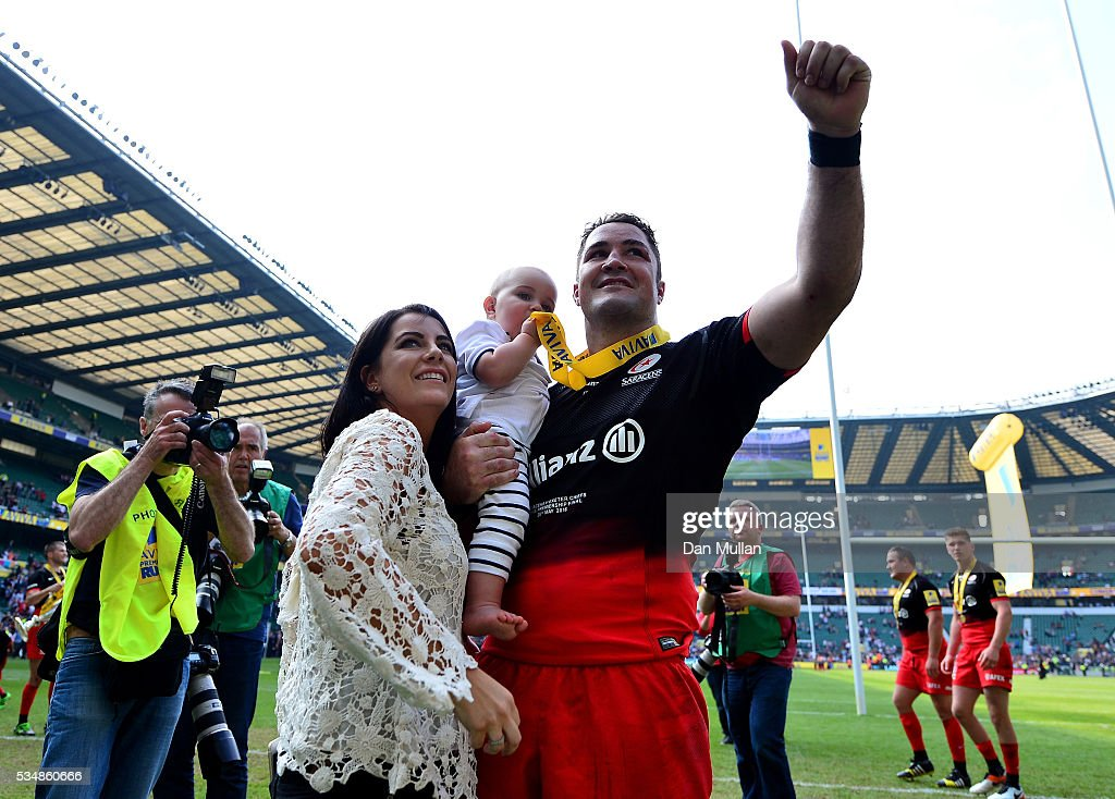 <a gi-track='captionPersonalityLinkClicked' href=/galleries/search?phrase=Brad+Barritt&family=editorial&specificpeople=4542508 ng-click='$event.stopPropagation()'>Brad Barritt</a> of Saracens and his family celebrate after the Aviva Premiership final match between Saracens and Exeter Chiefs at Twickenham Stadium on May 28, 2016 in London, England.