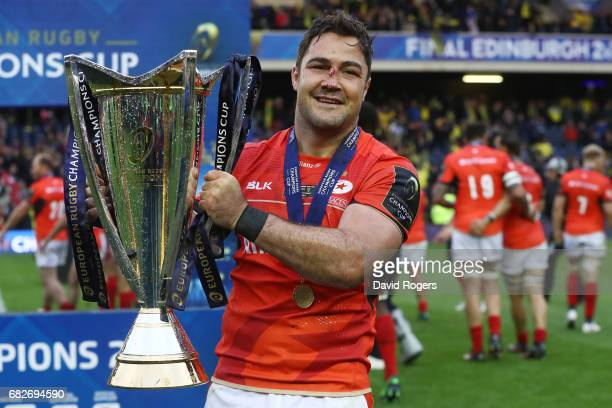 Brad Barritt of Saracens celebrates with the trophy following his team's 2817 victory during the European Rugby Champions Cup Final between ASM...