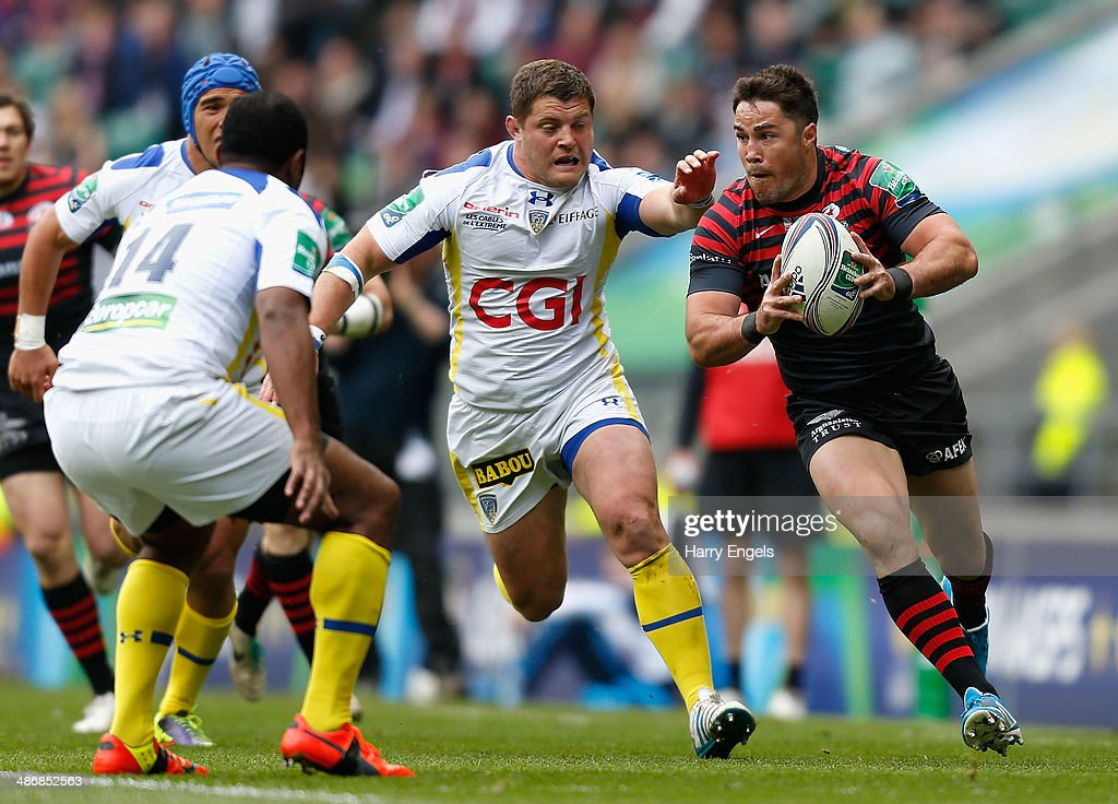 <a gi-track='captionPersonalityLinkClicked' href=/galleries/search?phrase=Brad+Barritt&family=editorial&specificpeople=4542508 ng-click='$event.stopPropagation()'>Brad Barritt</a> of Saracens charges up the wing away from <a gi-track='captionPersonalityLinkClicked' href=/galleries/search?phrase=Benjamin+Kayser&family=editorial&specificpeople=2117538 ng-click='$event.stopPropagation()'>Benjamin Kayser</a> of Clermont during the Heineken Cup Semi-Final match between Saracens and ASM Clermont Auvergne at Twickenham Stadium on April 26, 2014 in London, England.