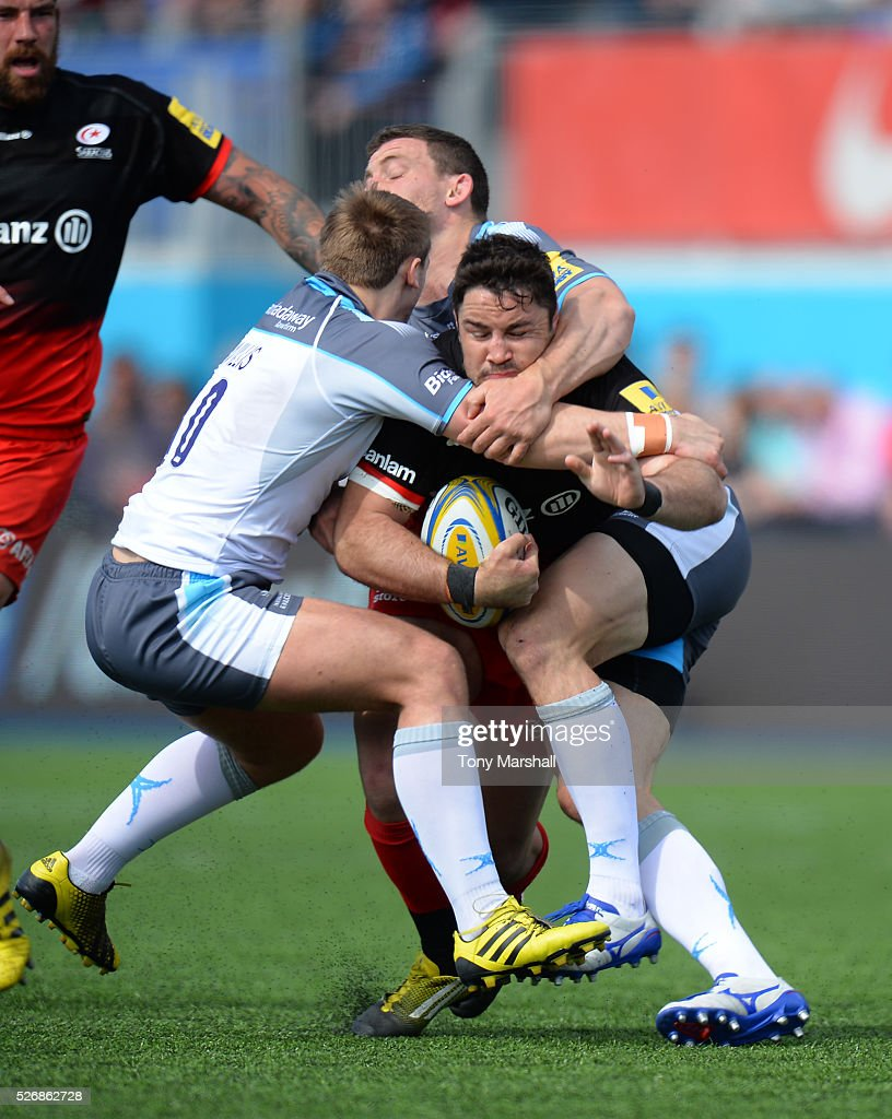 <a gi-track='captionPersonalityLinkClicked' href=/galleries/search?phrase=Brad+Barritt&family=editorial&specificpeople=4542508 ng-click='$event.stopPropagation()'>Brad Barritt</a> of Saracens is tackled by <a gi-track='captionPersonalityLinkClicked' href=/galleries/search?phrase=Mark+Wilson+-+Joueur+de+rugby&family=editorial&specificpeople=3913950 ng-click='$event.stopPropagation()'>Mark Wilson</a> and Craig Willis of Newcastle Falcons during the Aviva Premiership match between Saracens and Newcastle Falcons at Allianz Park on May 1, 2016 in Barnet, England.