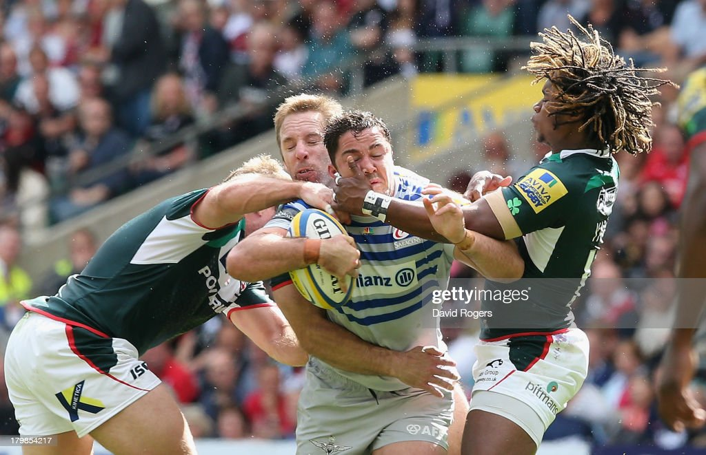 <a gi-track='captionPersonalityLinkClicked' href=/galleries/search?phrase=Brad+Barritt&family=editorial&specificpeople=4542508 ng-click='$event.stopPropagation()'>Brad Barritt</a> of Saracens is tackled by <a gi-track='captionPersonalityLinkClicked' href=/galleries/search?phrase=Marland+Yarde&family=editorial&specificpeople=6587696 ng-click='$event.stopPropagation()'>Marland Yarde</a> (R) and David Paice during the Aviva Premiership match between London Irish and Saracens at Twickenham Stadium on September 7, 2013 in London, England.