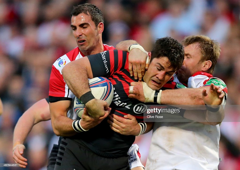 <a gi-track='captionPersonalityLinkClicked' href=/galleries/search?phrase=Brad+Barritt&family=editorial&specificpeople=4542508 ng-click='$event.stopPropagation()'>Brad Barritt</a> of Saracens is tackled by <a gi-track='captionPersonalityLinkClicked' href=/galleries/search?phrase=Ruan+Pienaar&family=editorial&specificpeople=591032 ng-click='$event.stopPropagation()'>Ruan Pienaar</a> of Ulster during the Heineken Cup Quarter-Final match between Ulster and Saracens at Ravenhill on April 5, 2014 in Belfast, Northern Ireland.