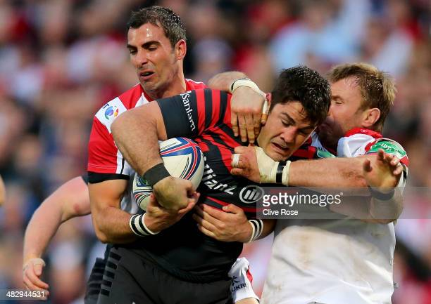 Brad Barritt of Saracens is tackled by Ruan Pienaar of Ulster during the Heineken Cup QuarterFinal match between Ulster and Saracens at Ravenhill on...
