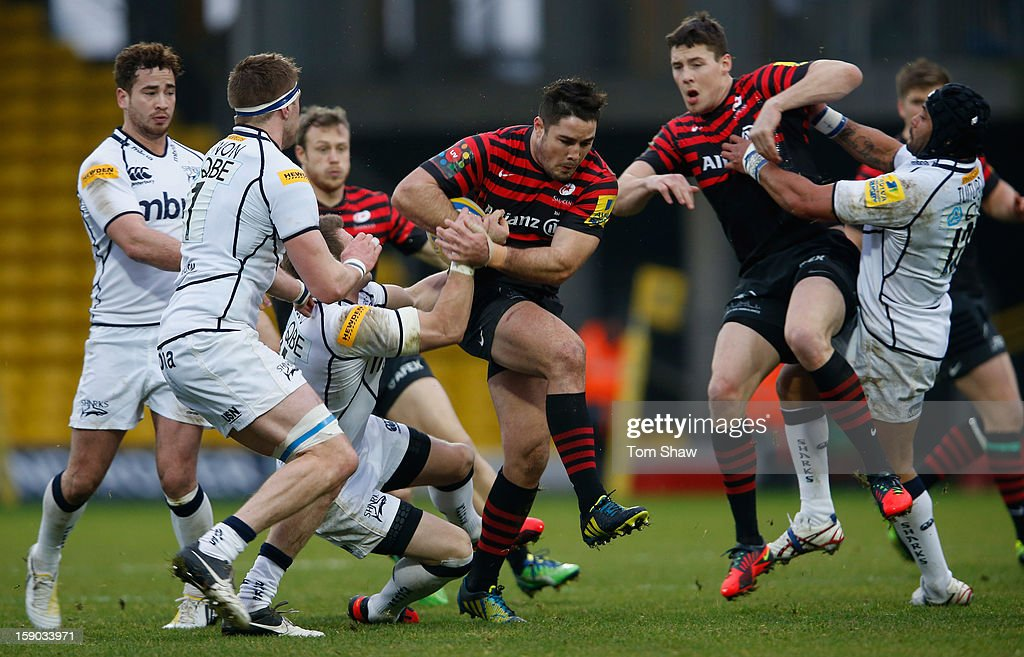 <a gi-track='captionPersonalityLinkClicked' href=/galleries/search?phrase=Brad+Barritt&family=editorial&specificpeople=4542508 ng-click='$event.stopPropagation()'>Brad Barritt</a> of Saracens is tackled during the Aviva Premiership match between Saracens and Sale Sharks at Vicarage Road on January 6, 2013 in Watford, England.
