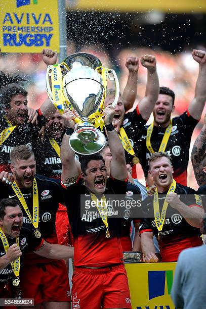Brad Barritt of Saracens lifts the trophy after the Aviva Premiership final match between Saracens and Exeter Chiefs at Twickenham Stadium on May 28...
