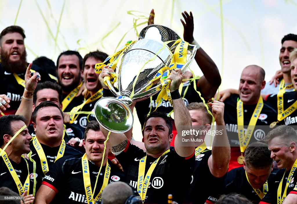 <a gi-track='captionPersonalityLinkClicked' href=/galleries/search?phrase=Brad+Barritt&family=editorial&specificpeople=4542508 ng-click='$event.stopPropagation()'>Brad Barritt</a> of Saracens lifts the trophy after voctory in the Aviva Premiership final match between Saracens and Exeter Chiefs at Twickenham Stadium on May 28, 2016 in London, England.