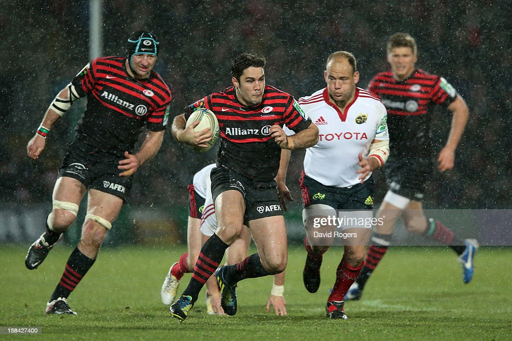 <a gi-track='captionPersonalityLinkClicked' href=/galleries/search?phrase=Brad+Barritt&family=editorial&specificpeople=4542508 ng-click='$event.stopPropagation()'>Brad Barritt</a> of Saracens makes a break during the Heineken Cup pool one match between Saracens and Munster at Vicarage Road on December 16, 2012 in Watford, United Kingdom.