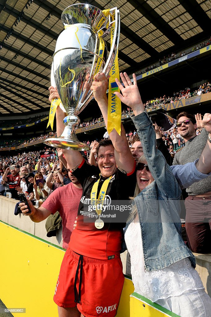 <a gi-track='captionPersonalityLinkClicked' href=/galleries/search?phrase=Brad+Barritt&family=editorial&specificpeople=4542508 ng-click='$event.stopPropagation()'>Brad Barritt</a> of Saracens poses for photographs with supporters after the Aviva Premiership final match between Saracens and Exeter Chiefs at Twickenham Stadium on May 28, 2016 in London, England.