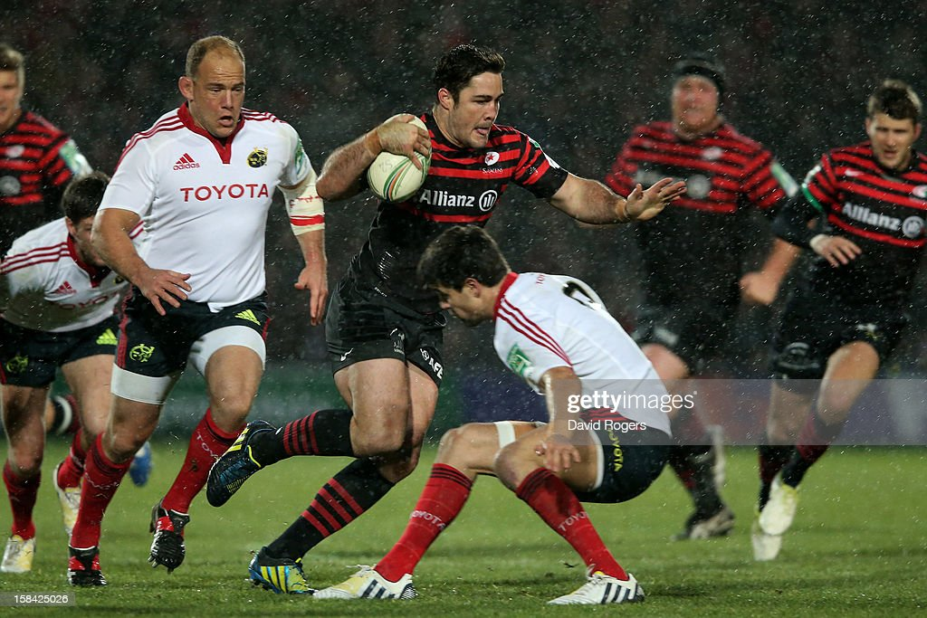 <a gi-track='captionPersonalityLinkClicked' href=/galleries/search?phrase=Brad+Barritt&family=editorial&specificpeople=4542508 ng-click='$event.stopPropagation()'>Brad Barritt</a> of Saracens splits the Munster defence during the Heineken Cup pool one match between Saracens and Munster at Vicarage Road on December 16, 2012 in Watford, United Kingdom.