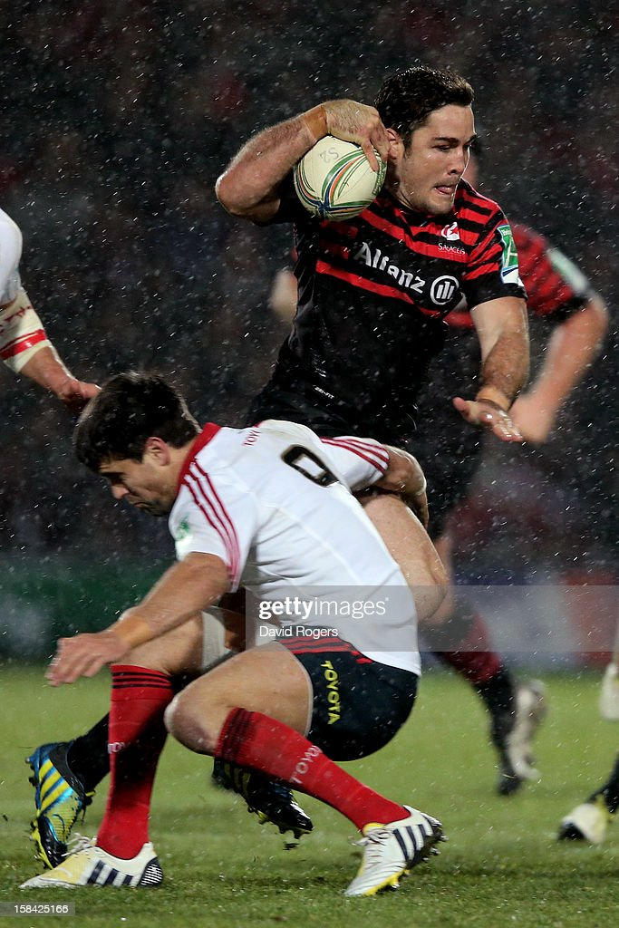 <a gi-track='captionPersonalityLinkClicked' href=/galleries/search?phrase=Brad+Barritt&family=editorial&specificpeople=4542508 ng-click='$event.stopPropagation()'>Brad Barritt</a> of Saracens steps inside Conor Murray of Munster during the Heineken Cup pool one match between Saracens and Munster at Vicarage Road on December 16, 2012 in Watford, United Kingdom.