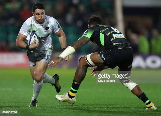 Brad Barritt of Saracens takes on Courtney Lawes during the European Rugby Champions Cup match between Northampton Saints and Saracens at Franklin's...