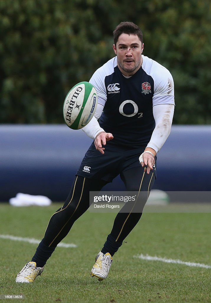 <a gi-track='captionPersonalityLinkClicked' href=/galleries/search?phrase=Brad+Barritt&family=editorial&specificpeople=4542508 ng-click='$event.stopPropagation()'>Brad Barritt</a> passes the ball during the England training session held at Pennyhill Park on February 6, 2013 in Bagshot, England.