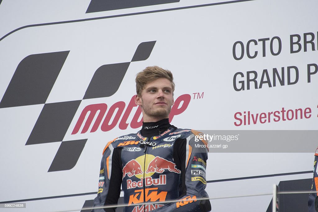Brad Binder of South Africa and Red Bull KTM Ajo celebrate the victory on the podium at the end of the Moto3 race during the MotoGp Of Great Britain - Race at Silverstone Circuit on September 4, 2016 in Northampton, England.