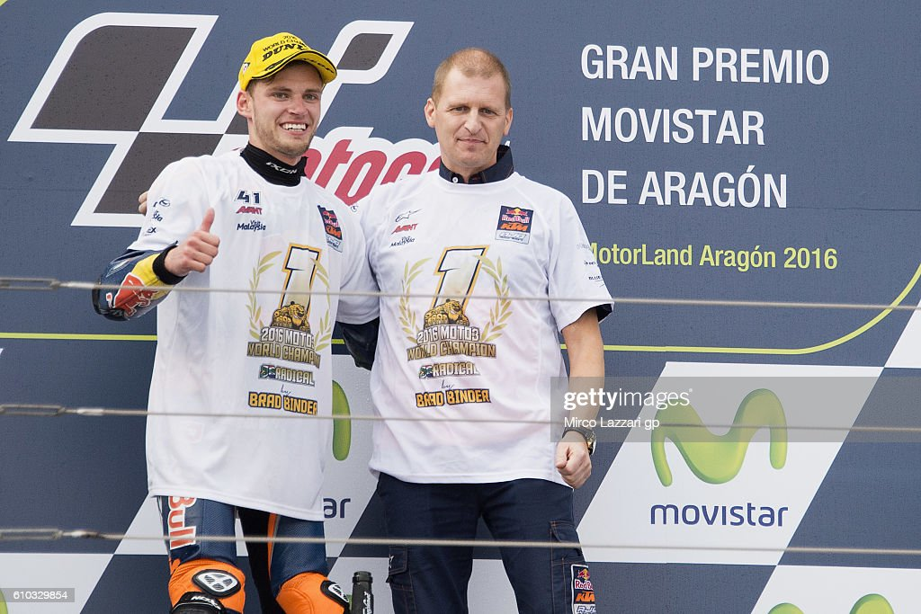 Brad Binder (L) of South Africa and Red Bull KTM Ajo celebrates the second place on the podium with Aki Ajo of Finland and becames the 2016 Moto3 World Champion (First South Africa rider) at the end of the moto3 race during the MotoGP of Spain - Race at Motorland Aragon Circuit on September 25, 2016 in Alcaniz, Spain.