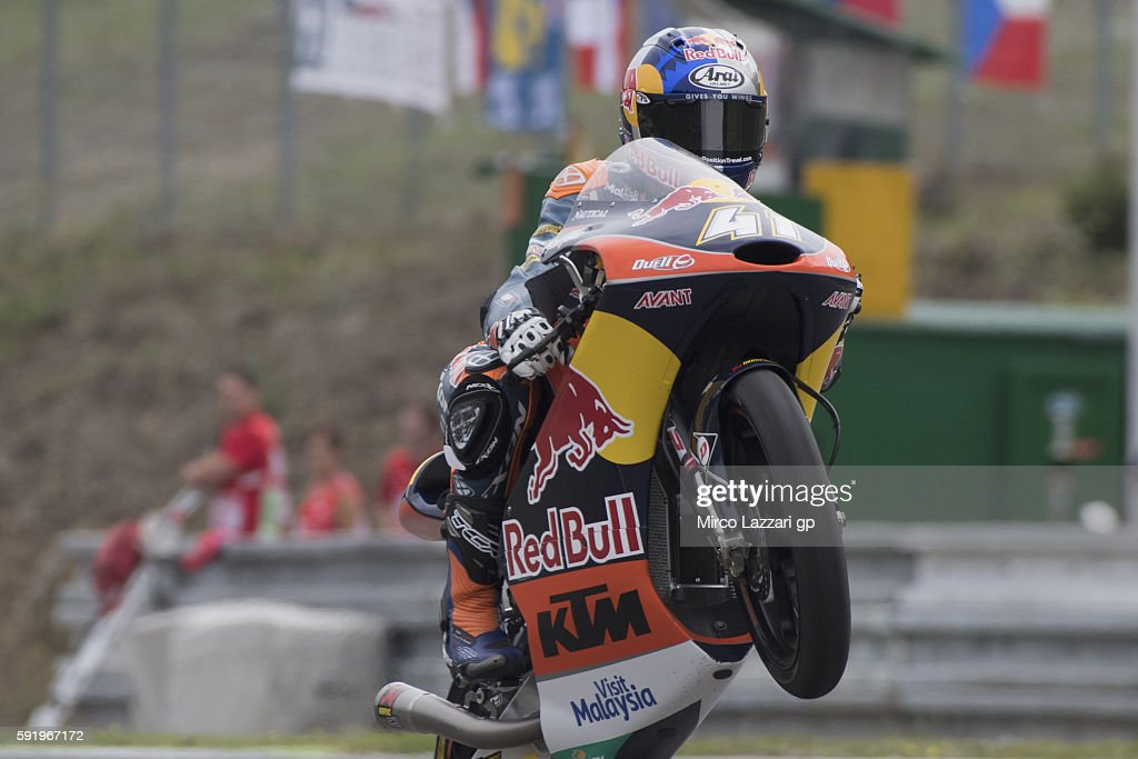 Brad Binder of South Africa and Red Bull KTM Ajo lifts the front wheel during the MotoGp of Czech Republic - Free Practice at Brno Circuit on August 19, 2016 in Brno, Czech Republic.