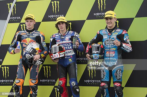 Brad Binder of South Africa and Red Bull KTM Ajo Niccolo Antonelli of Italy and Ongetta Rivacold and Aron Canet of Spain and Estrella Galicia 00 pose...
