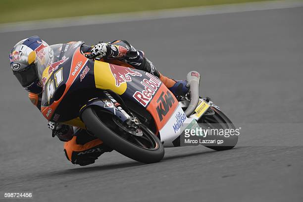 Brad Binder of South Africa and Red Bull KTM Ajo rounds the bend during the MotoGp Of Great Britain Free Practice at Silverstone Circuit on September...