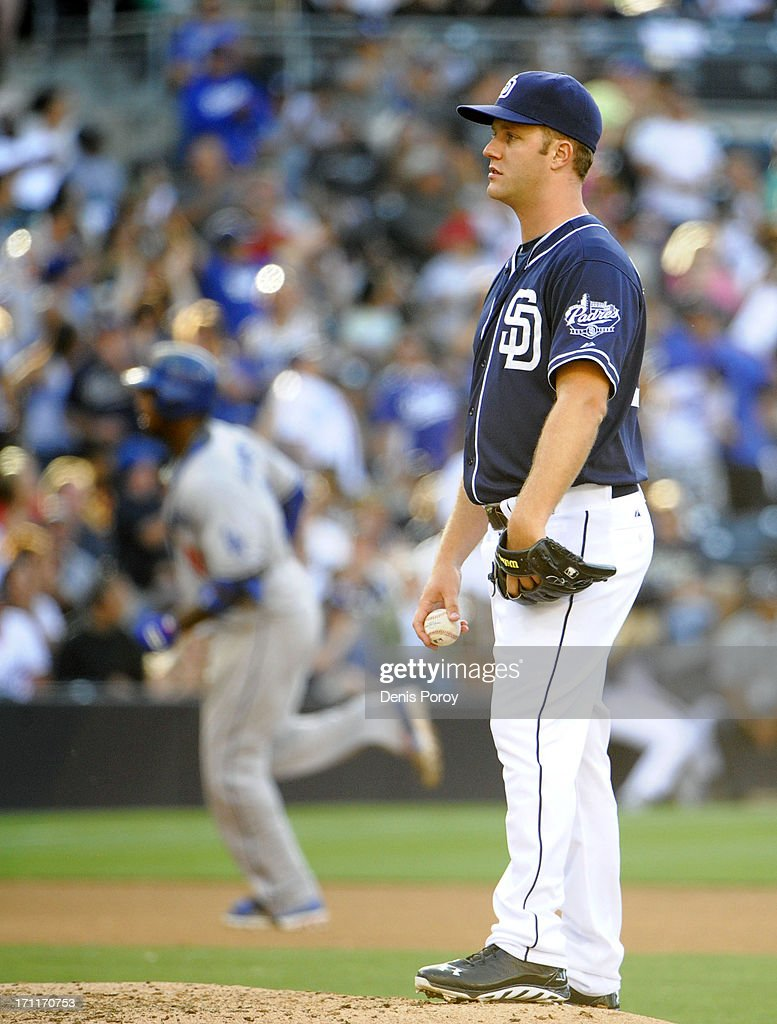 Brad Boxberger #29 of the San Diego Padres stands on the mound as <a gi-track='captionPersonalityLinkClicked' href=/galleries/search?phrase=Hanley+Ramirez&family=editorial&specificpeople=538406 ng-click='$event.stopPropagation()'>Hanley Ramirez</a> #13 of the Los Angeles Dodgers rounds the bases after hitting a solo home run during the seventh inning of a baseball game at Petco Park on June 22, 2013 in San Diego, California.