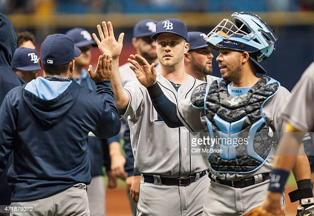 Brad Boxberger of the Tampa Bay Rays celebrates with Rene Rivera after the Rays win over the Baltimore Orioles on May 1 2015 at Tropicana Field in St...