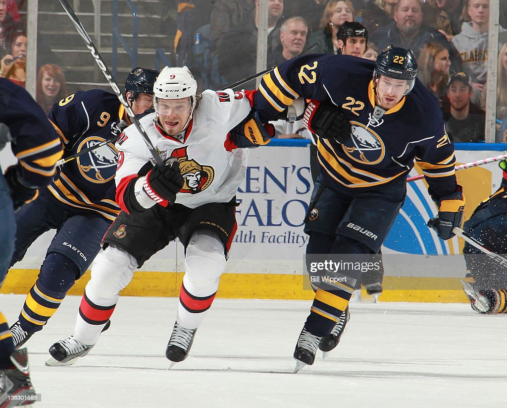<a gi-track='captionPersonalityLinkClicked' href=/galleries/search?phrase=Brad+Boyes&family=editorial&specificpeople=275014 ng-click='$event.stopPropagation()'>Brad Boyes</a> #22 of the Buffalo Sabres blocks the path of <a gi-track='captionPersonalityLinkClicked' href=/galleries/search?phrase=Milan+Michalek&family=editorial&specificpeople=544987 ng-click='$event.stopPropagation()'>Milan Michalek</a> #9 of the Ottawa Senators during the second period at First Niagara Center on December 31, 2011 in Buffalo, New York. Boyes received a holding penalty on the play.