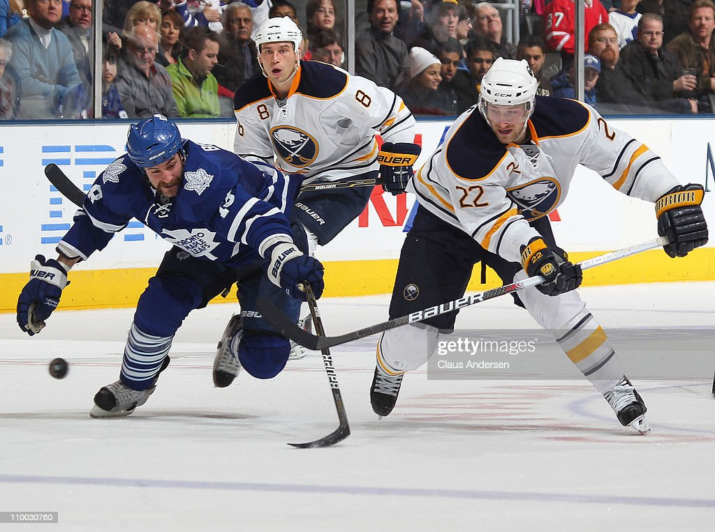 <a gi-track='captionPersonalityLinkClicked' href=/galleries/search?phrase=Brad+Boyes&family=editorial&specificpeople=275014 ng-click='$event.stopPropagation()'>Brad Boyes</a> #22 of the Buffalo Sabres skates away from a checking Mike Brown #18 of the Toronto Maple Leafs in a game on March 12, 2011 at the Air Canada Centre in Toronto, Canada. The Leafs defeated the Sabres 4-3.