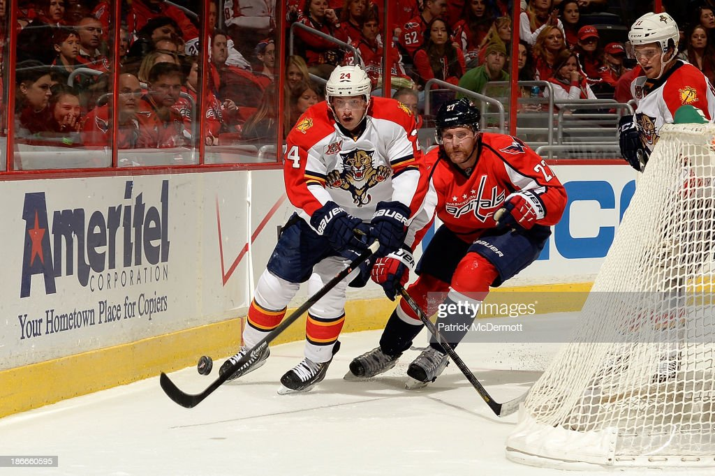 <a gi-track='captionPersonalityLinkClicked' href=/galleries/search?phrase=Brad+Boyes&family=editorial&specificpeople=275014 ng-click='$event.stopPropagation()'>Brad Boyes</a> #24 of the Florida Panthers and <a gi-track='captionPersonalityLinkClicked' href=/galleries/search?phrase=Karl+Alzner&family=editorial&specificpeople=3938829 ng-click='$event.stopPropagation()'>Karl Alzner</a> #27 of the Washington Capitals chase after the puck during the third period of an NHL game at Verizon Center on November 2, 2013 in Washington, DC.